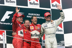 The podium: Rubens Barrichello, Jean Todt, Michael Schumacher and David Coulthard
