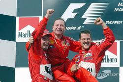 Michael Schumacher, Rubens Barrichello and Jean Todt celebrating