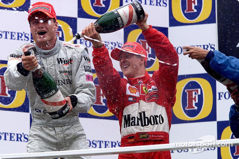 Le podium: David Coulthard et Michael Schumacher