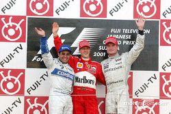 El podio: el ganador de la carrera, Michael Schumacher con Juan Pablo Montoya y David Coulthard
