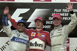 The podium: race winner Michael Schumacher with Juan Pablo Montoya and David Coulthard