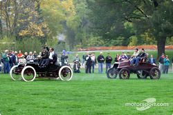 In a reenactment of Henry Ford's 1901 race victory over Alexander Winton, Ford's Glenn Miller and drag racing great Bob Glidden drive a replica of Ford's Sweepstakes racer to the lead
