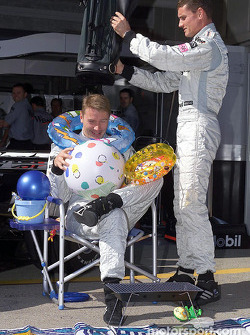 David Coulthard presenting Mika Hakkinen with his gifts