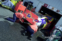NASCAR officials check Andy Houston's Ford Taurus with templates as the McDonalds machine is inspected prior to practice