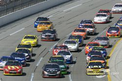 Andy Houston and Jeremy Mayfield lead the pack through the tri-oval at Talladega