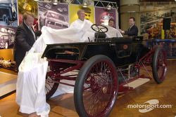 Edsel B. Ford II, Dale Jarrett (1999 NASCAR Winston Cup Champion), John Force (ten-time NHRA Funny Car Champion), and Steve Hamp (Director of Henry Ford Museum and Greenfield Village) unveil the restored original Ford 1901 Sweepstakes