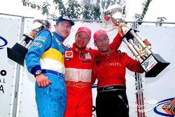 El podio: los ganadores Mario Haberfeld, Rubens Barrichello y Tony Kanaan