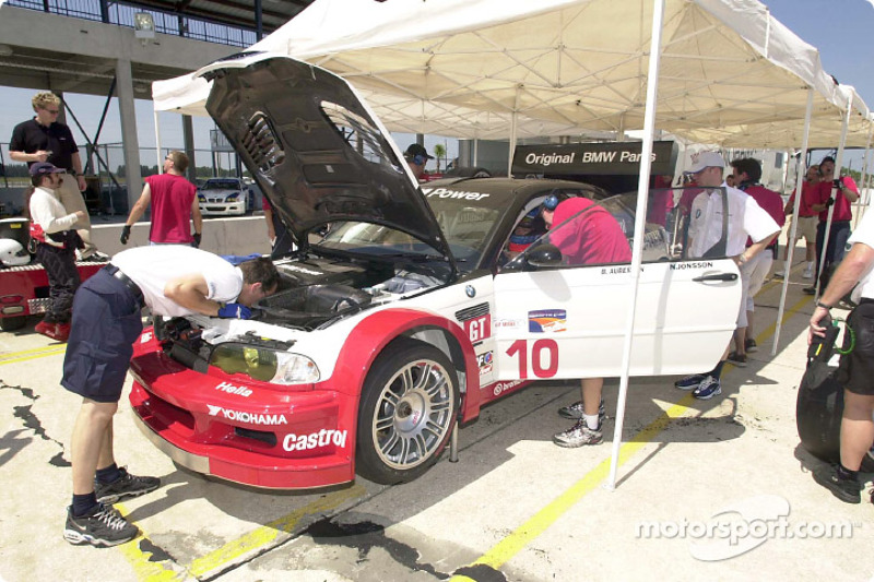 Team PTG and BMW Motorsport technicians look over the new Team PTG M3 GTR as Bill Auberlen prepares for another phase of a three-day test at Sebring International Raceway