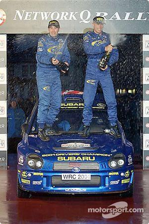 Richard Burns and Robert Reid celebrating