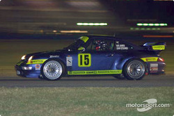 The lights of Daytona International Speedway fly by as the #15 Motorsport Technologies Porsche races in the infield