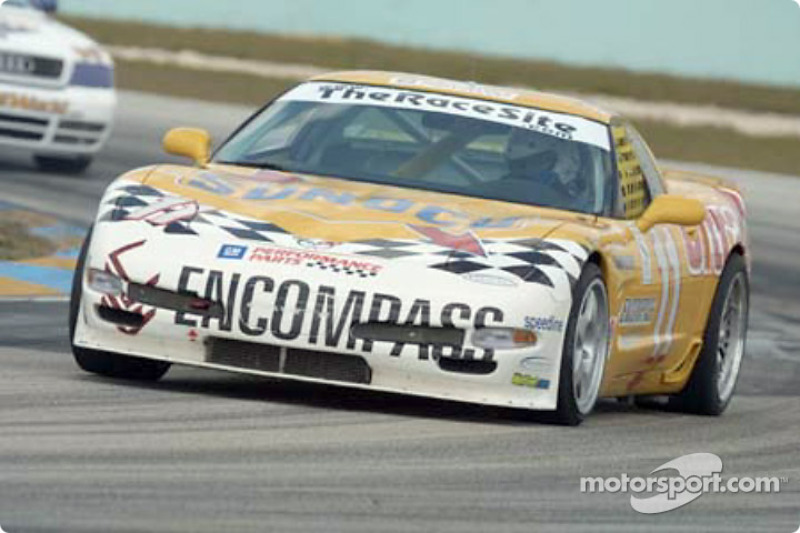 The #11 Powell Motorsports Corvette rounds a curve