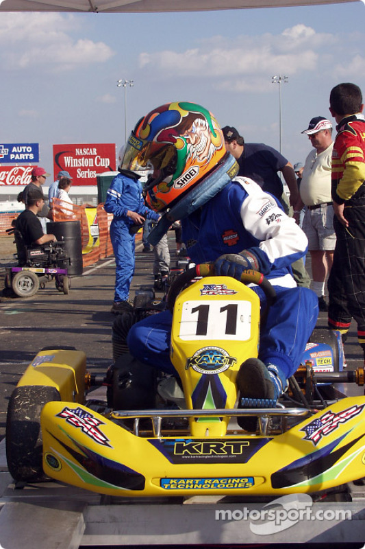 HPV Junior Sportsman winner #11-James Kennedy pushes his kart to the scale after his win