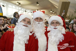 The traditional Children's Christmas at Ferrari: Rubens Barrichello, Michael Schumacher and Luca Badoer