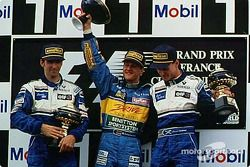 The podium: winner Michael Schumacher with Damon Hill and David Coulthard