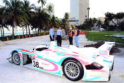Raceworks, LLC, President Peter Yanowitch and Principal Willy Bermello discuss the construction of the temporary racing circuit for the April 5-7 Grand Prix of the Americas in Downtown Miami with two of the workers