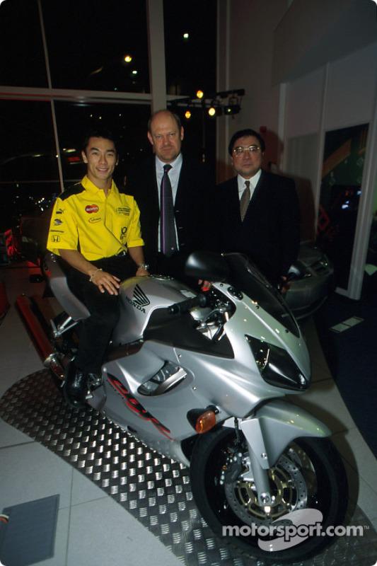 Takuma Sato with his partners