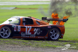 The #12 Ultima GTR belches flames as it tries to restart after spinning in the chicane in the early