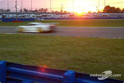 Car flashes as sun sets