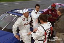 Scott Sharp discussing with Johnny Sauter, while Sam Hornish Jr. is watching