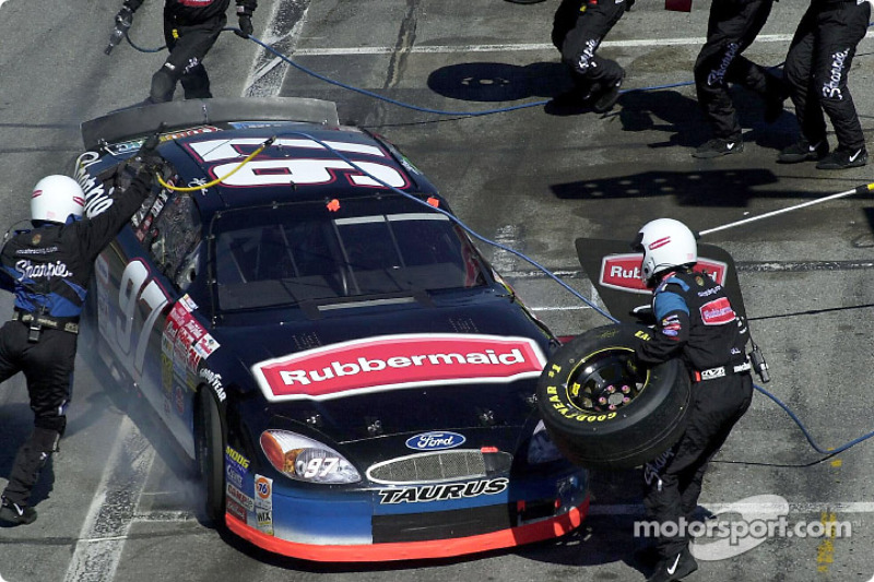 Kurt Busch locks up the brakes on the Rubbermaid Ford Taurus as he pits for service