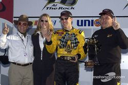 Matt Kenseth celebrating his win in the Subway 400 at Rockingham with wife Katie, team owner Jack Roush and crew chief Robbie Reiser