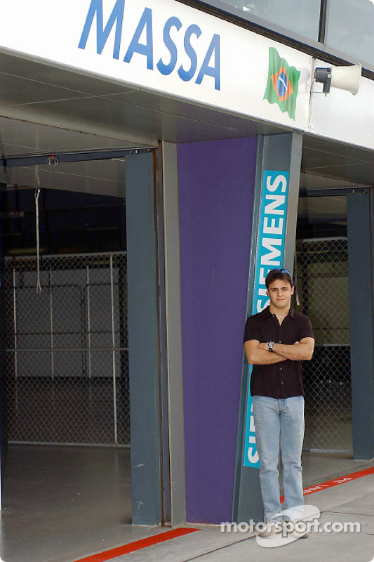 Formula 1 rookie Felipe Massa seeing his name above a Grand Prix garage for the first time
