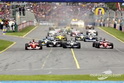 The start: Rubens Barrichello, David Coulthard, Ralf Schumacher and Michael Schumacher leading the c