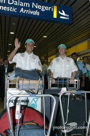 Felipe Massa and Nick Heidfeld at the airport