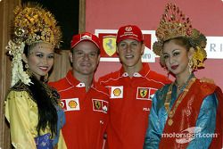 Rubens Barrichello and Michael Schumacher with local beauties