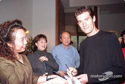 Sponsorship ceremony for Pan Global Kuala Lumpur: Mark Webber logoing autographs