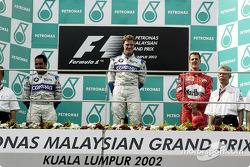 Le podium : le vainqueur Ralf Schumacher, Juan Pablo Montoya et Michael Schumacher