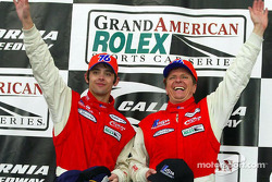 Fredy Lienhard Jr. and Didier Theys wave from Victory Lane at the Grand American 400