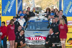 Winner Gilles Panizzi celebrating with Team Peugeot