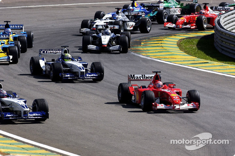 First corner: Michael Schumacher about to pass Juan Pablo Montoya