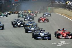 The start: Juan Pablo Montoya and Michael Schumacher charging to the first corner