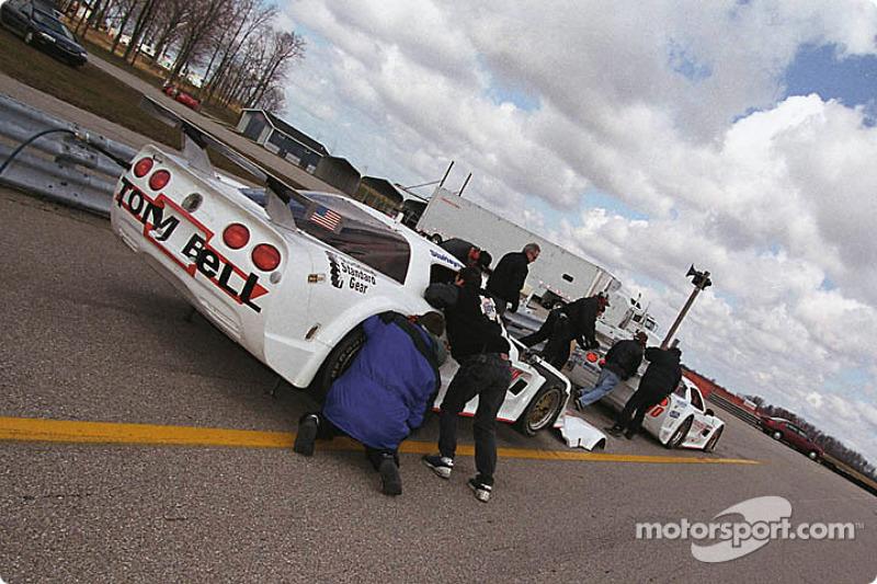 The team works on the Corvettes of Don Sak and Stu Hayner