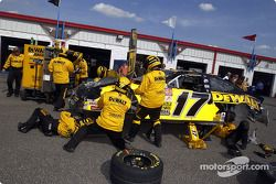 The Dewalt crew work on the damaged Ford Taurus of Matt Kenseth
