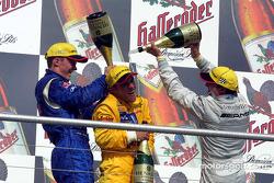 Champagne for race winner Laurent Aiello, Mattias Ekström and Jean Alesi