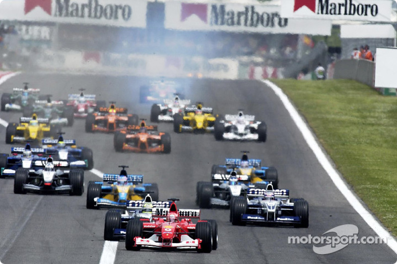 start: Michael Schumacher taking lead front, Ralf Schumacher