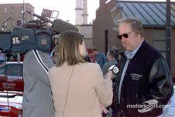 Brock Yates talks to the media