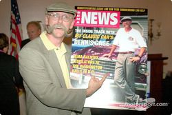 Dennis Gage proudly displays his SEMA commemorative cover
