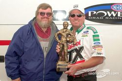 Motorsport.com's Greg Gage presents EMPA's Driver of the Year trophy to John Force; this turned out