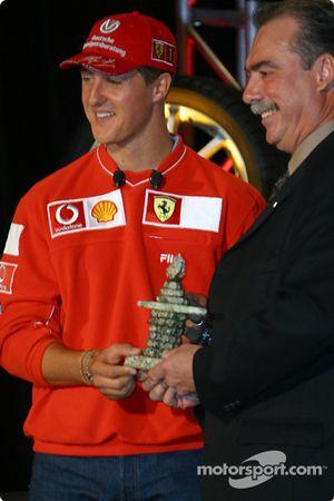Bridgestone Motorsport / Scuderia Ferrari press conference: Michael Schumacher receiving an Inuit sculpture from Robert Vetter of Brigdestone Canada
