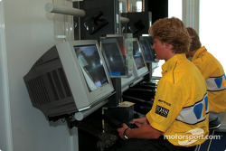 Nico Rosberg playing on a Playstation in the Formula BMW hospitality