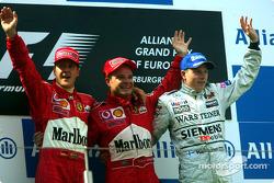 Podium: Sieger Rubens Barrichello, 2. Michael Schumacher, 3. Kimi Räikkönen