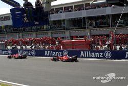 Rubens Barrichello taking checkered flag front, Michael Schumacher