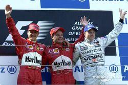 Подиум: победитель гонки Рубенс Баррикелло, Михаэль Шумахер и Кими Райкконен