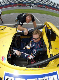 A member of the Blackforest Motorsports crew shows Rusty Wallace some features in the #06 Ford-powered Riley & Scott