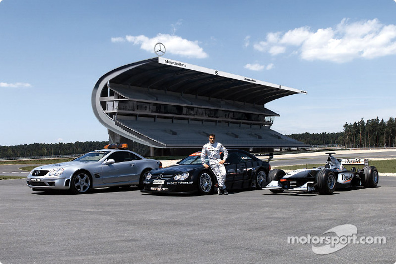 Jean Alesi with the F1 Safety Car Mercedes-Benz SL 55 AMG, his own Mercedes-Benz CLK-DTM and David Coulthard's West McLaren Mercedes in front of the new Mercedes grandstand at the re-designed part of Hockenheim's Grand Prix circuit