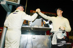 Rob and Chris Dyson celebrate their team's victory in pit lane as James Weaver captures the checkered flag